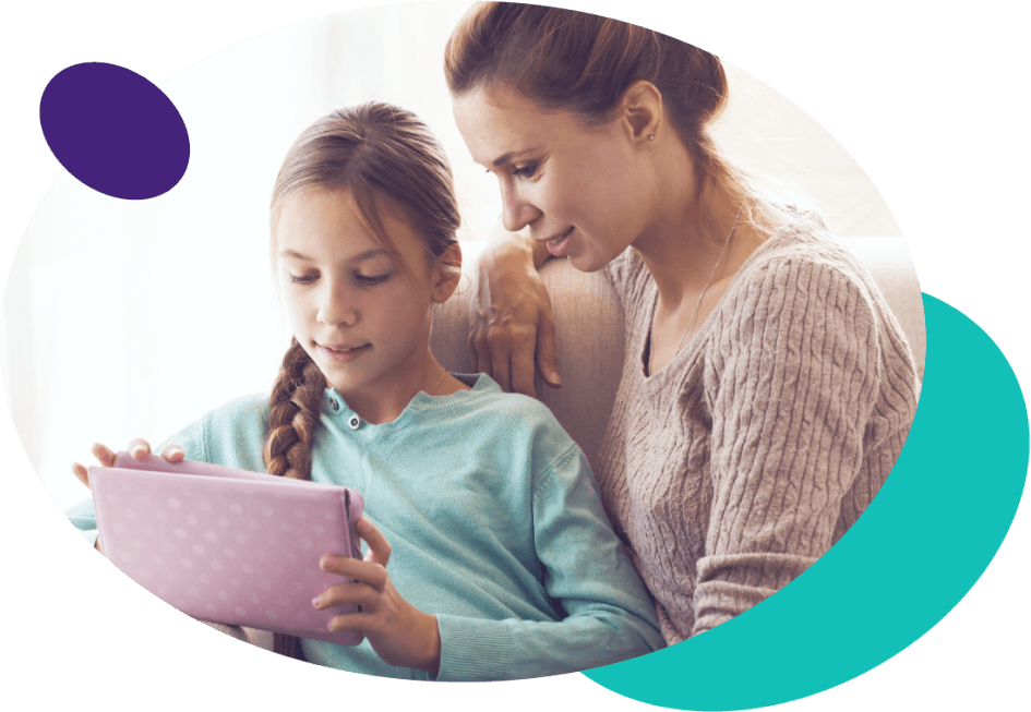 Parent and kid using tablet together