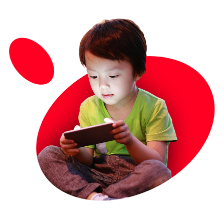 Child using mobile device on red background