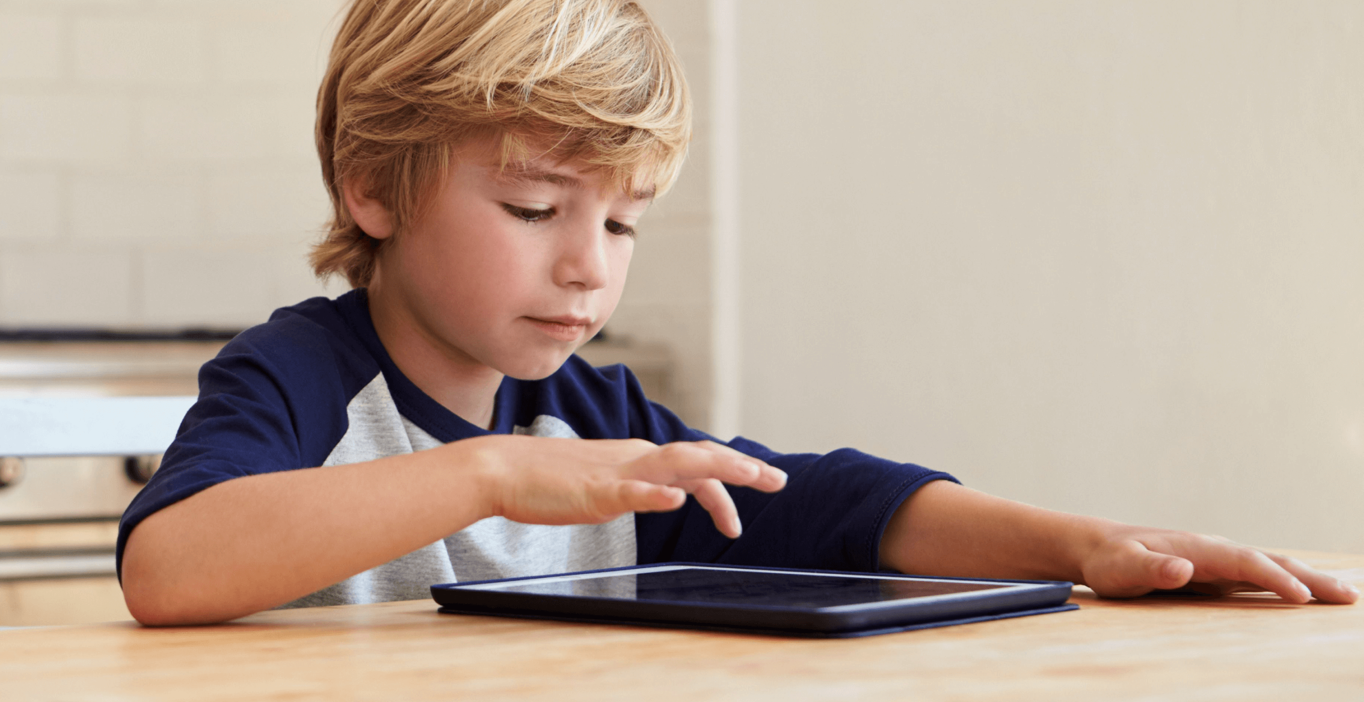 boy-with-ipad-table